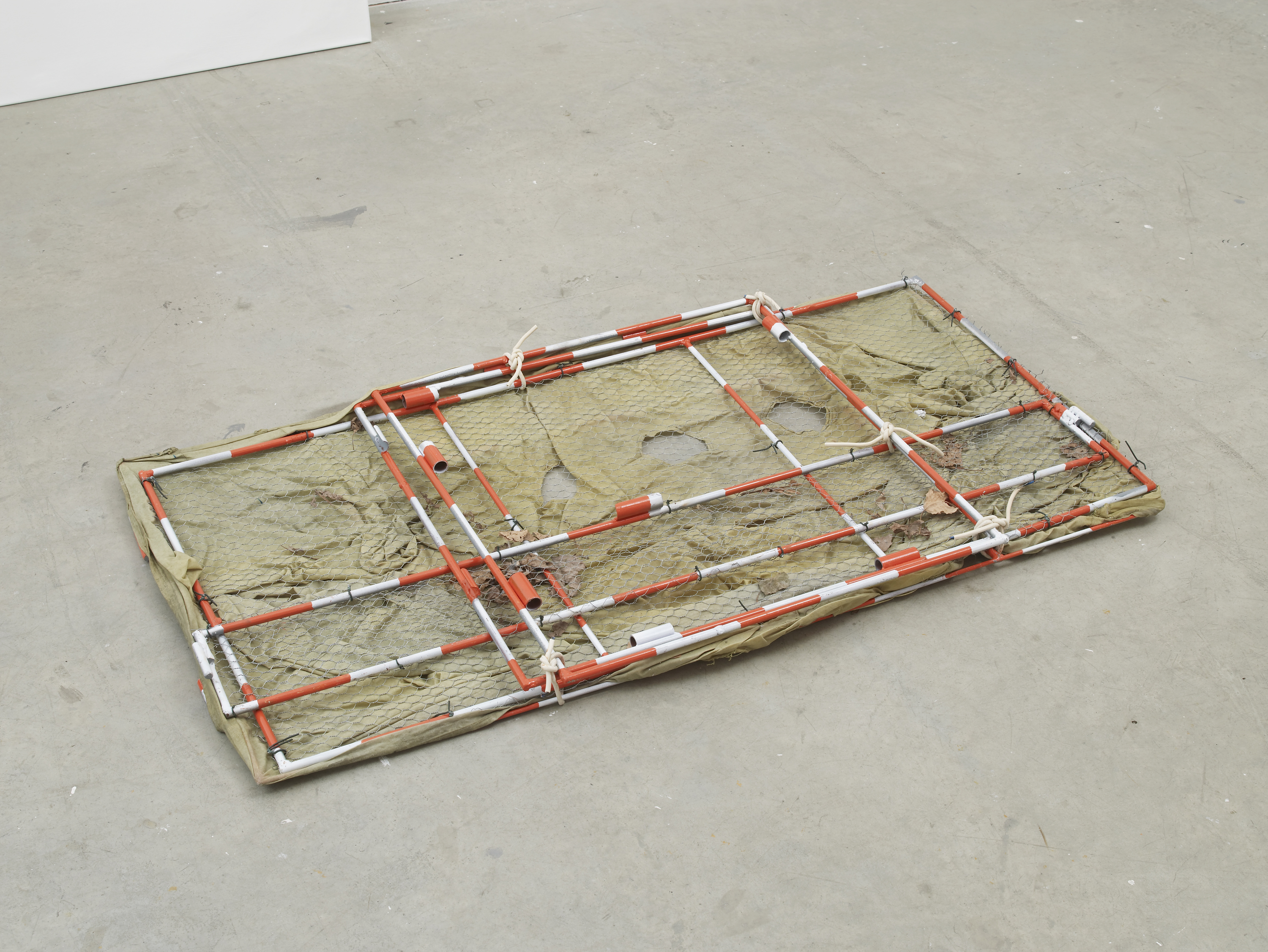 Stuart Middleton, Untitled, 2016  steel, paint, chicken wire, oil cloth , 5 x 64 x 124 cm, 2 x 25 1/4 x 48 7/8 ins. Being There Organised by Matt Williams , NeÏl Beloufa,  Hannah Black,  Eliza Douglas,  Klara Lidén,  Colin Lowe & Roddy Thomson,  Stuart Middleton and Avery Singer